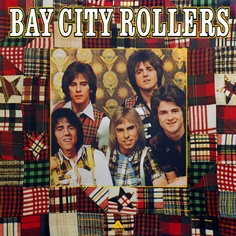 Bay City Rollers - my style many years ago!! Even had the plaid on my pants legs, the striped suspenders and the plaid scarf!!! Eric was and still is my favorite!!