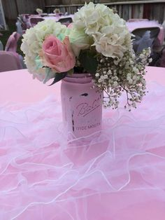 Pink mason jar floral arrangement at a shabby chic baby shower party! See more party ideas at CatchMyParty.com!