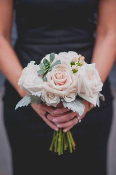 Small bridesmaid bouquet with roses, succulent, dust miller and berries | October 2014 | Hamilton ON | www.kjandco.ca | KJ and Co. planning and coordination at modern elegant rustic Art Gallery Of Hamilton wedding | Photo by Selina Whittaker Photography | pink white and peach bridesmaid bouquet with roses, dusty miller, peach berries and succulents