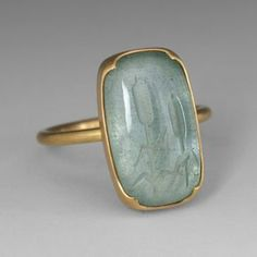 This Gabriella Kiss ring features an yellow gold setting with a rectangular aquamarine that is carved with two cattails. This unusual stone is set in the artist's signature scalloped bezel. This ring has a lovely, subtle appeal when worn alone, or yo Modern Jewelry, Jewelry Art, Jewelry Rings, Silver Jewelry, Vintage Jewelry, Jewelry Accessories, Jewelry Design, Unique Jewelry, Jewellery