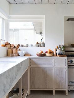 Solid ash cabinetry holds the weight of marble counters in this North Vancouver kitchen designed by Scott & Scott Architects.