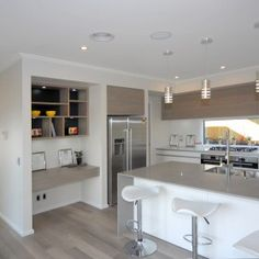 the kitchen in our hamilton showhome featuring a mirrored splash