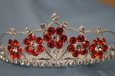 "(SMALL)Elegant Bridal Wedding Tiara Crown with Crystal Party Accessories DH5764(RED) by High Performance Parts. $9.99. Perfect accessory for wedding, prom, pageant, birthday, or other special occasions. Red Crystals on Silver Crown. Elegant Bridal Wedding Tiara Crown With Crystal. Made by clear and High Quality crystals, and pearls. Size:3.5""x1.25""H (Small Crown). Jewelled wedding tiaras crown are the perfect accessory for wedding, prom, pageant, birthday, or other special ..."