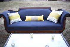 A refurbished vintage-inspired sofa and stylish modern coffee table make smashing additions to an al fresco cocktail hour.