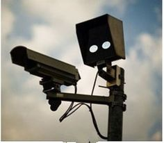 That's not a traffic camera, it's a robot with a gun!