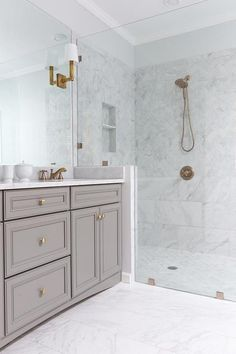 gray bathroom vanity/marble tile shower