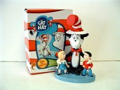 Dr Seuss Cat in the Hat 5 Inch Tall Bobblehead Figure. Cat in the Hat Bobblehead Figure. Features a seated Cat in the Hat with a boy and a girl. Stands 5 Inches Tall. Official Movie Product. Licensed by Universal Studios.