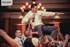 Celebrating with the groom at his Bella Collina wedding reception.  Wedding photo by Orlando Florida wedding photographer Brian Adams PhotoGraphics  www.brianadamsphoto.com