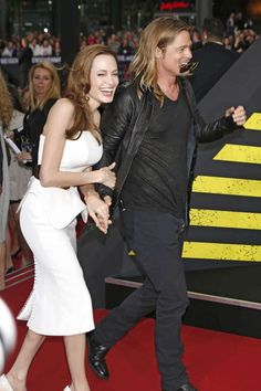 "Angelina Jolie and Brad Pitt's journey as a couple:      Take a look at Pitt and Jolie's numerous red carpet appearances together, over the years. ﴾Pictured﴿ The couple attends the premiere of ""World War Z"" in Berlin, Germany, on June 4, 2013."