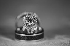Cushion cut diamond halo engagement ring with black and silver wedding band | villasiena.cc