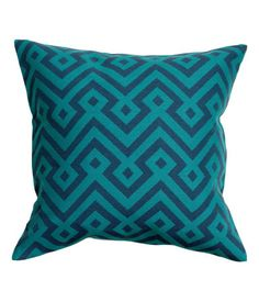 Cushion cover with a jacquard-weave front section. Solid-color backing. Concealed zip. Size 20 x 20 in.