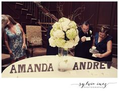 Place card table with wooden letter names and tall centerpiece of hydrangeas and branches. #wedding #weddings #bride #WeddingIdeas #decor #DIY #photography #weddingphotos #weddingphotography #weddingdress #nj #photographer #weddinginspiration #woodletters #hydrangeas #centerpiece #weddingflowers