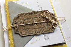 These beautiful Sonoma Valley wedding invitations from Molly at Paisley Quill are so chic and romantic!  Molly wanted to reflect the vineyard location in a unique way, so she incorporated a cork veneer tag and yellow baker's twine as a belly band for the invitation suite.  Love it!