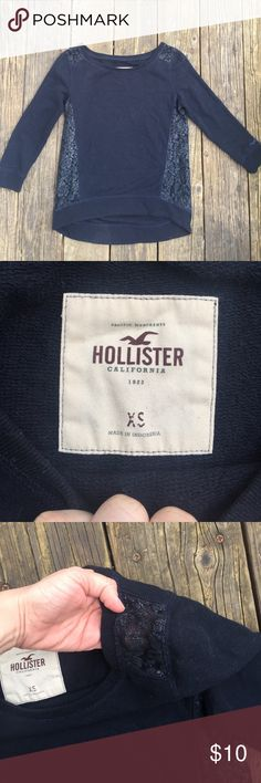 Hollister sweater Dark navy holister sweater. Has navy see through lace on the sides and part of the shoulders. Good condition! Will lent roll this before I send it 😅 Hollister Sweaters