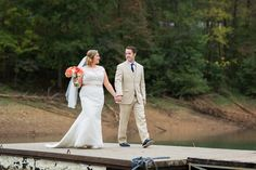 Bride and Groom Holding Hands Walking on Dock and Coral Bouquet Wedding Photo | www.hannahandrandall.com
