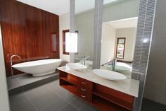 I am in love with this gorgeous bathroom design. It has such a relaxing feel to it.