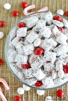 Easy Chocolate Peppermint Muddy Buddies (also called Puppy Chow, Chex Mix) recipe using dark chocolate and white chocolate peppermint M&Ms and candy canes!