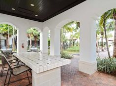 Grab some friends and grill out at the BBQ area at AMLI Toscana Place apartments in Davie, FL