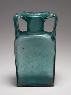 Glass rectangular bottle Period: Mid Imperial,  2nd–3rd century A.D. - Culture: Roman - Glass; mold-blown