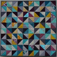 Ridiculous is pinning items already favourited in Flickr... It happens... HST quilt with solids, neutrals & busier patterns. Love the balance!  /////  Streetscape in Triangles by katie@swimbikequilt, via Flickr
