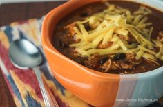 Sunday Slow Cooker: Chicken Enchilada Soup   Slender Kitchen.   Using low sodium broth to cut down on salt. Fresh green chiles rather than canned. Low-fat cheese. Yum!
