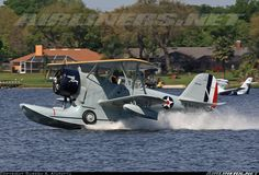 "Kermit Weeks lands his Duck named the ""Candy Clipper"" on Lake Agnes which is located adjacent to his private airport. Grumman J2F-6 Duck (G-15), Polk City - Worlds Greatest Aircraft Collection (FA08) USA - Florida, April 3, 2014"