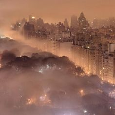 Photo of New York's Central Park at night as the clouds drift by below.  photo by Jim Richardson