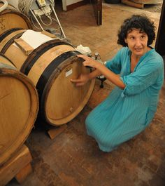 Elisabetta Dalzocchio with a barrique coming from Romanee Conti in her cellar near Trento, Italy.