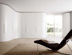 Sleek curves sweeping into corner wardrobe to maximise space