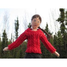 This is an aran sweater for the Theodora doll with design elements from a Japanese stitch dictionary (100 Aran Patterns). The sweater shown was made with a 2-ply fingering weight handspun yarn and requires less than 50 g.