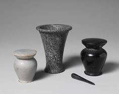 Kohl stick and cosmetic containers. Obsidian. Egypt, ca.1981-1802 B.C. | Middle Kingdom | The Met