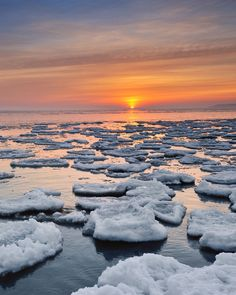 """Floating Ice""  Winter sunrise on Michigan's Lake Huron shoreline by John McCormick on 500px"