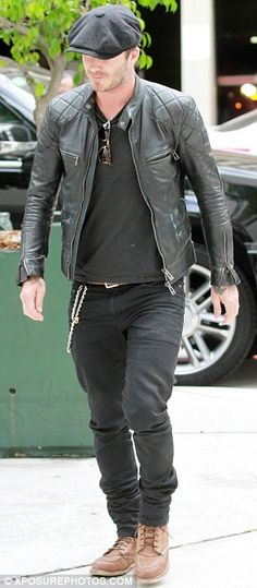 David Beckam Hunky: As he arrived he wore his trademark baker boy cap and baggy jeans
