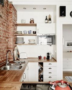 Small space done perfectly. via @domainehome #scandinavian #brickwall #minimalist #simplicity #whiteliving