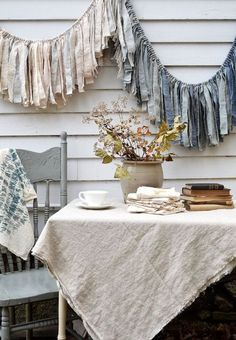 I like the cloth on the table. I like linen and different fabrics 'Tempest' fabric garland banner in greys, blues, cream, and taupe - by Untold Imprint. Drop Cloth Curtains, Cafe Curtains, Diy Curtains, Kitchen Curtains, Hippie Curtains, Homemade Curtains, Patterned Curtains, Purple Curtains, Luxury Curtains