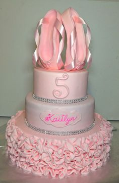 Ballerina princess cake. Fondant ruffles, diamond wraps and hand sculpted ballet pointe shoes on top.