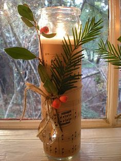 Slender jar candles at the grocery store for $1.50 each! Wrap them in  brownish, vintage sheet music and hung vintage crystals from an old chandelier.  To finish them, add fresh greens with berries.