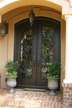 Custom wrought iron double entry door with arch top.
