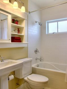 Love, love, love the cabinet and shelves over the commode and sink.