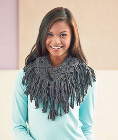 Add a timeless touch to any outfit with an Endless Loop Scarf with Fringe Trim. This beautiful, soft knit scarf is easy to wear. Simply slip it over your head.