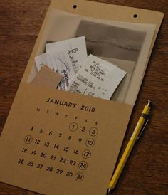 calendar pocket ~ stuff all the bills and notes for each month .. smart
