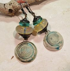 by Sheri Mallery, Porcelain charm dangle earrings.  http://www.amazon.com/Handmade-Bohemian-CeramicPorcelain-Textured-Earrings/dp/B015X0CJ8C?ref=hnd_dp_car_mba_2