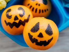 Mandarin Pumpkins : With a black permanent marker, draw ribs, eyes and a mouth on a sweet mandarin orange, then slip it into a lunchbox or snack bag.