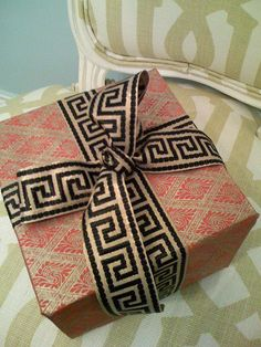 Don't be afraid to put two different , yet sophisticated prints together for an elegantly wrapped gift wrap #giftwrap #patterns #ribbon