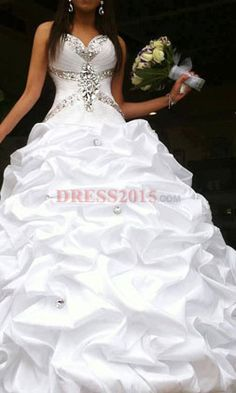 This is my favorite wedding dress. Love the flow of it, and love the bling.