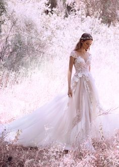 Galia Lahav Gala IV Collection GALA-902 GALA is their premium made-to-order bridal line, for the young vibed-bride, handmade with love in Tel-Aviv. Impressive ball gown dress with a rosé sheer tulle skirt with handmade flower appliques and off the shoulder sleeves.