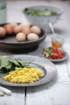 """""""Really good scrambled eggs"""" by Teresa Cutter. She uses natural yoghurt or coconut milk in the recipe instead. -- I made these eggs with yoghurt and they were a success, yum!"""