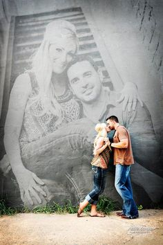 Couple photo infront of large blank wall then digitally add a portrait shot. This would be cute as an anniversary picture.  Have the couple now posing with an old engagement picture in the background.