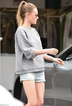 Casual customer: The actress dressed down in a baggy jumper and tiny shorts, pulling her hair into a ponytail