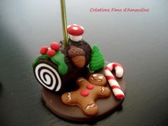 Marque place fimo spécial Noël buche, sucre d'orge, pain d'épice  base ronde de diamètre 4cm hauteur total avec tige d'accroche 11 cm - 873832